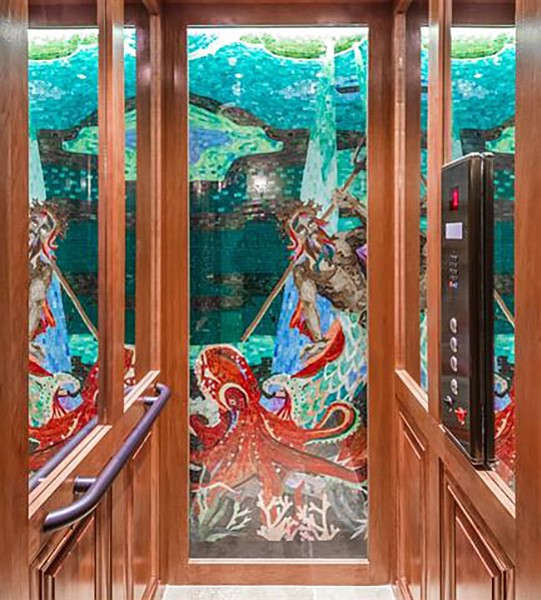 Mosaics are seen on every floor through the glass elevator