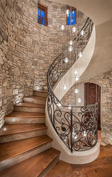 Stairs and noted glass chandelier