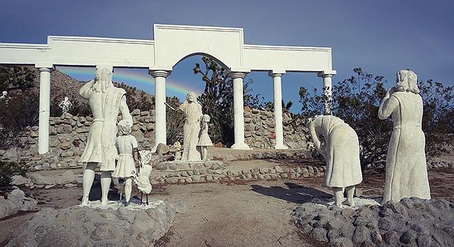 An omen fills the sky above Desert Christ Park.