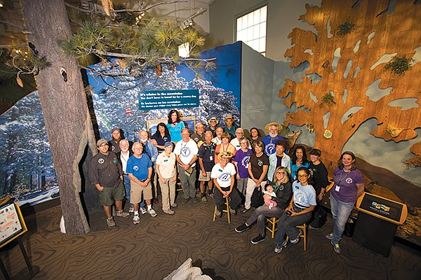 Canyoneers in front of Coast to Cactus exhibit at Natural History Museum. Exhibit shows San Diego as one of 35 biodiversity hotspots representing  one-third of the world's vertebrate animals and 44 percent of the vascular plants.