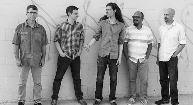 """Ian Tordella (far right) on the name Moth & Sons: """"This group has a lot of rough edges...a moth is a less beautiful version of a butterfly."""""""