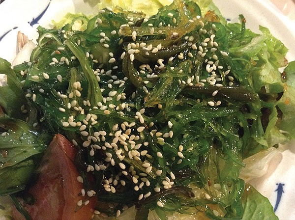 Kanpai's seaweed sits on a pile of lettuce, showered with sesame seeds.
