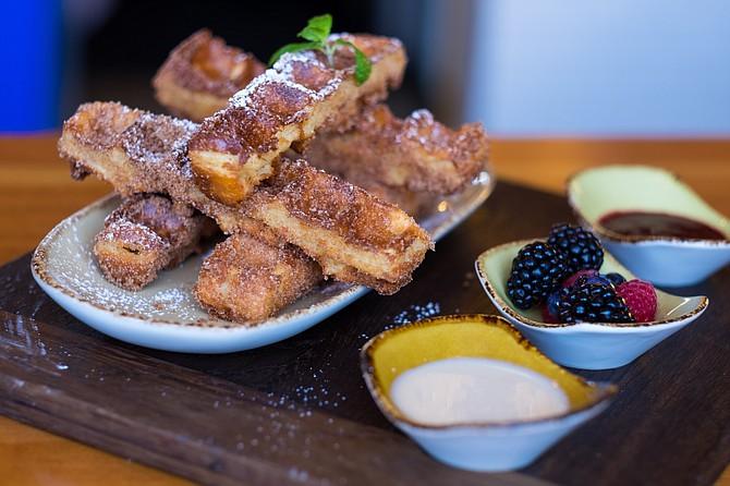 Waffled Churro Sticks with maple cream cheese sauce, blackberry jam, and fruit