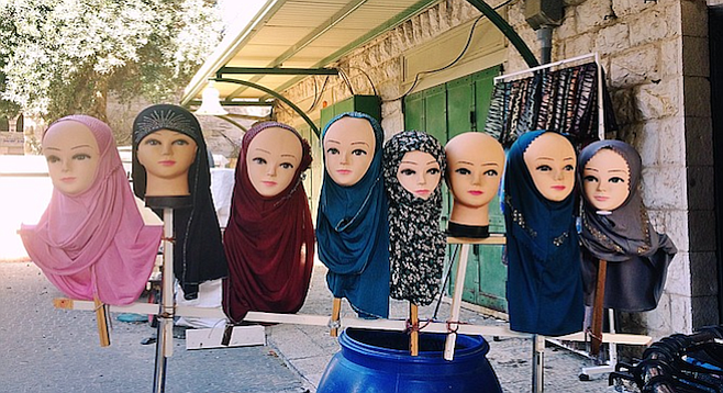 Valley of the Hajib Dolls... outside a shop in Nazareth.
