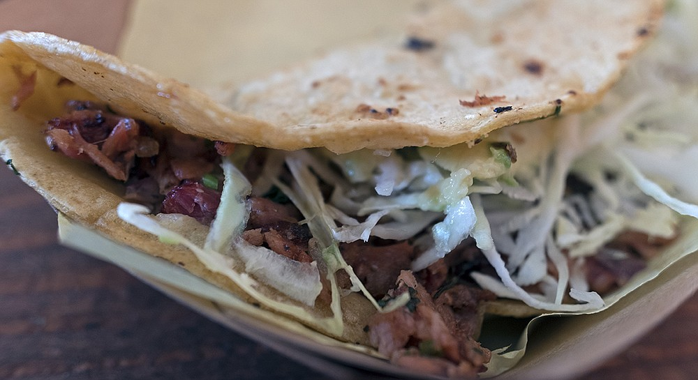 The siren call of the smoked tuna taco — shredded cabbage, avocado, and cheese on a soft corn tortilla