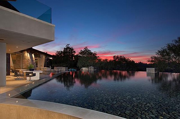"""The pool and water features were designed with seamless integration between the home and landscape."""