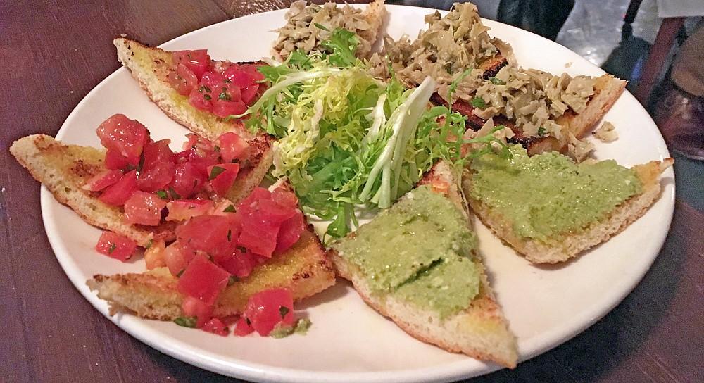 Tomato, artichoke, and green olive pate bruschetta