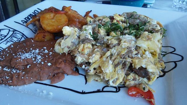 Bracero's machaca con huevos — tender and spicy.