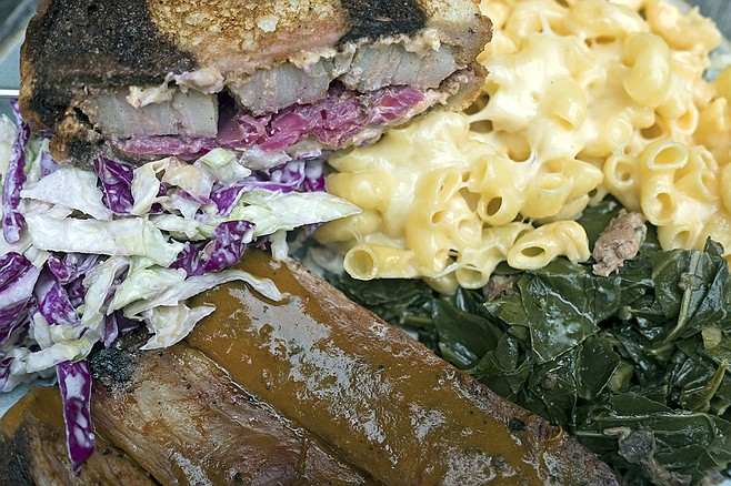 Clockwise from bottom: ribs, coleslaw, pork belly Reuben, mac'n'cheese, and collard greens.