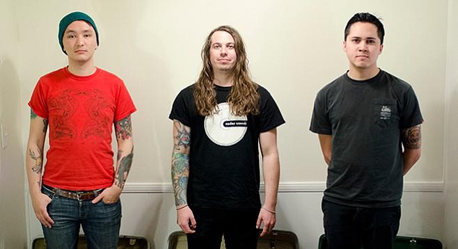 Drummer/singer Caskitt (center) says he's sick of watching vain lead singers. - Image by Kyle Herrera
