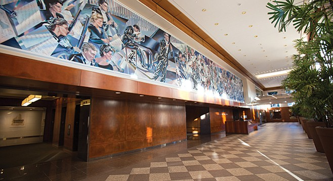 The mural in the lobby of downtown's Symphony Towers hints at the hidden Copley Symphony Hall hidden within.