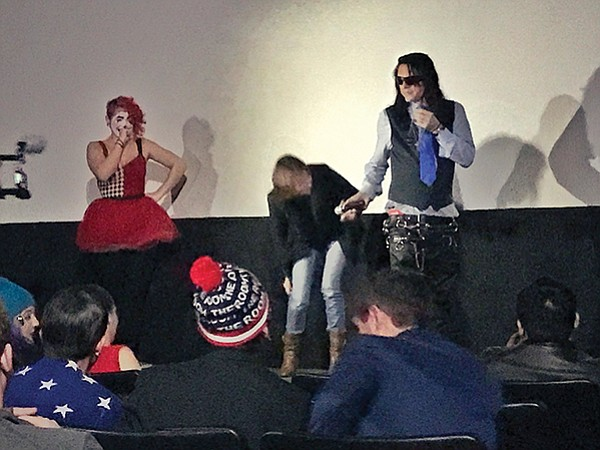 Scarlet Checkers may or may not be knitting Tommy Wiseau.