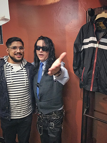 International man of mystery Tommy Wiseau poses with a fan.