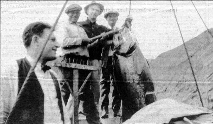 "Frank Bompensiero in foreground (c.1920). Mary Ann: ""First, he unloaded fish, and then he got a job as a fisherman because that's all they knew."""
