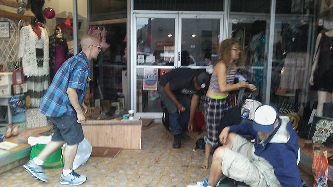 Some of the loiterers who regularly camped at the store's entrance (October 2016)