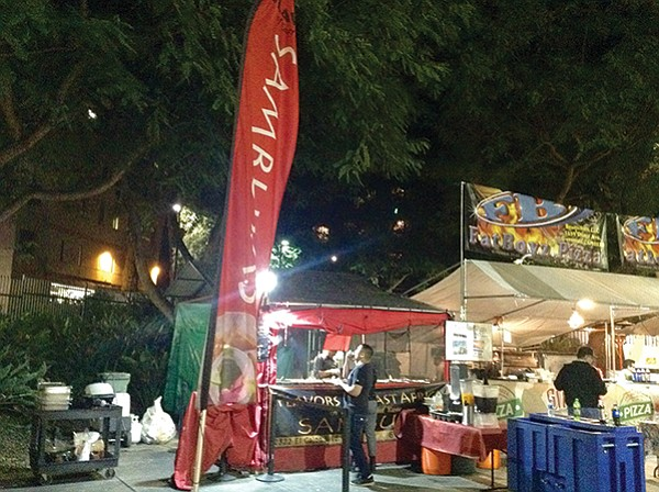 Flavors of East Africa's little tent under mighty SDSU trees