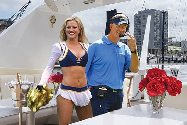 Saluting the haters: Coach Mike McCoy aboard his yacht The Surreal McCoy in happier days.