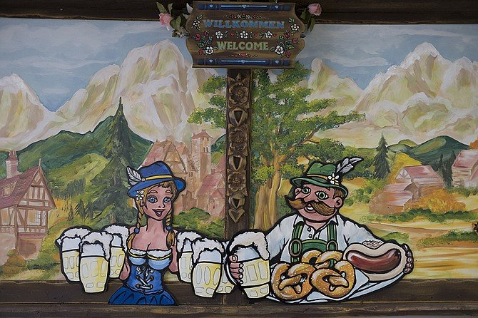 A few of these somewhat goofy murals adorn the walls at Sausage & More