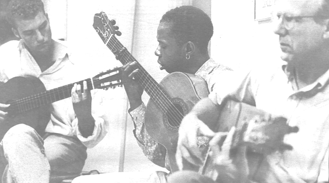 """Guitarists at dance lessons, Jeanne's Dance Studio, Bay Park. """"For flamenco guitar, for many years, our mission was only to accompany. We don't have to worry about the melody."""""""