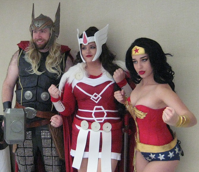 Thor (published by Marvel Comics), Sif (character from Thor) and Wonder Woman (published by DC Comics) at San Diego Comic Fest