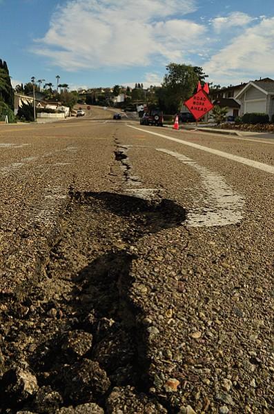Golfcrest Drive near the base of Cowles Mountain (with road work signs suggesting repairs are underway).