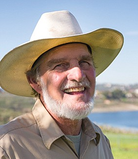"""Mike Kukuchek: """"That's country,"""" Kukuchek says, pointing to a pile of his horse Bandit's feces."""