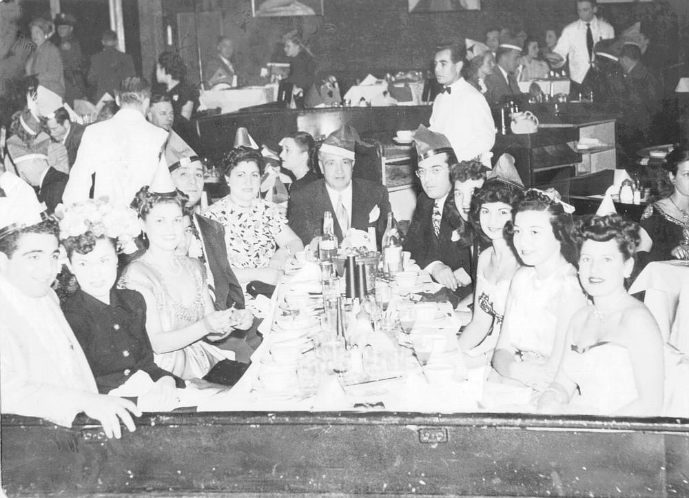 From left: Frankie Drangna, Frankie's date, Marie Adamo, Momo Adamo, Frances Dragna, Jack Dragna, Frank Desimone, Anna Dragna (third from right), Mary Ann (far right); New Year's Eve, 1947