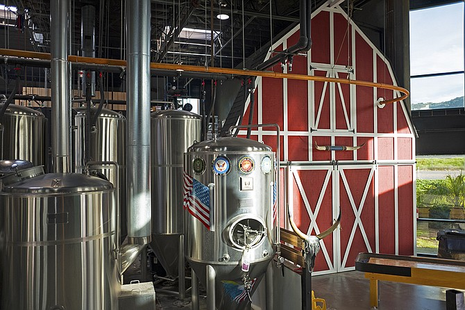 The beer made in these tanks is not allowed inside the barn.