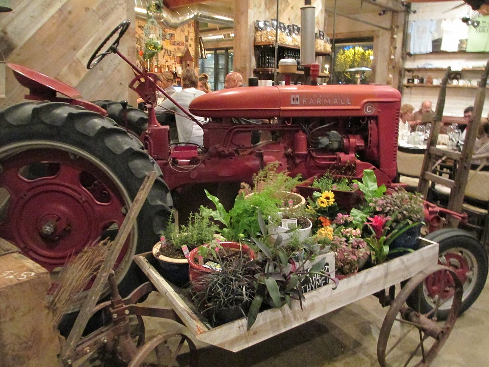 A 1940's tractor is the centerpiece of the room.