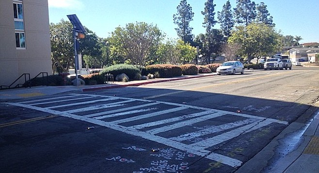 The crosswalk in front of the senior tower on Cowley Way, one of the first in the city with warning lights embedded in the street.