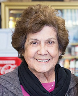 Ofie Escobedo and her sister run Lola's 7-Up store since the 1980s.