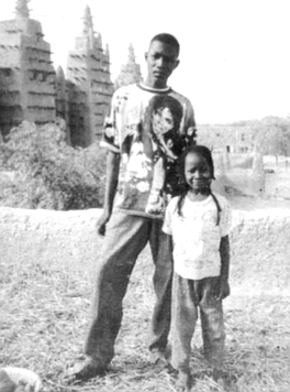 Dtenne guide Yelfa and his sister. Djenne mosque in background.