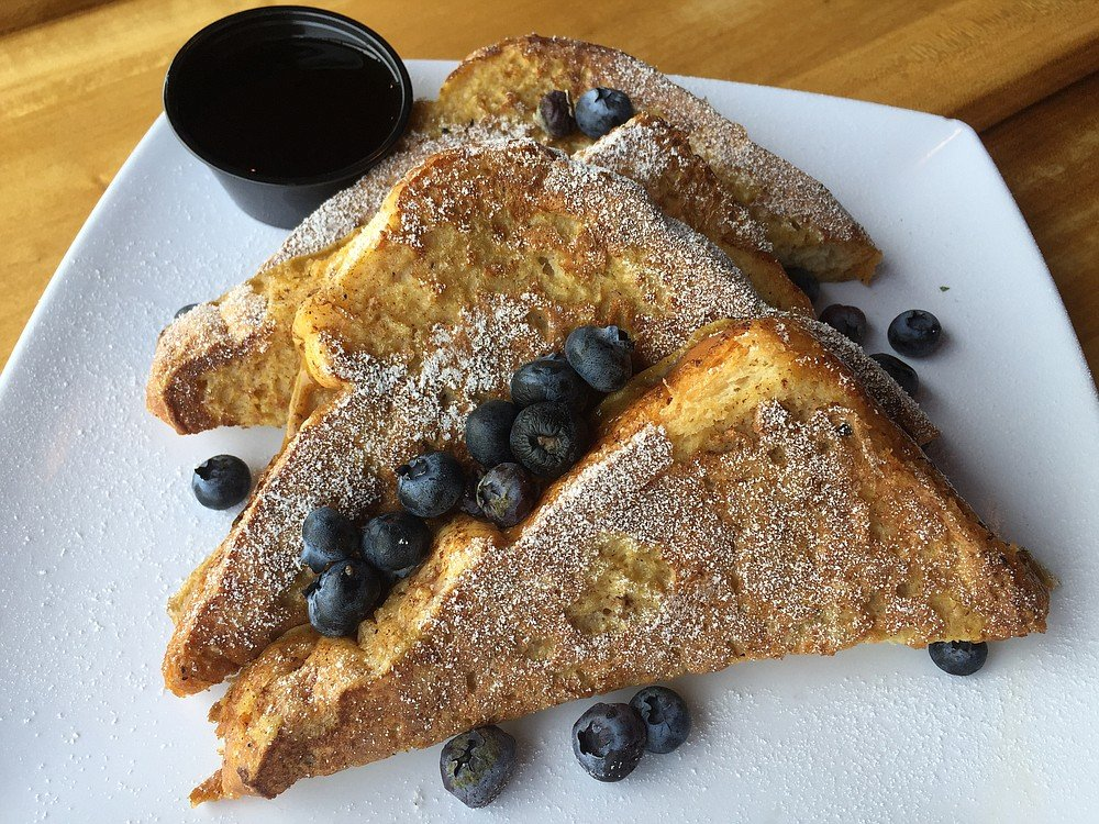 The Brioche French Toast has thick white bread dipped in a cinnamon/brown-sugar egg wash.