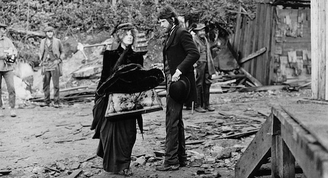 An opium-smoking madame (Julie Christie) propositions a small-time gambler (Warren Beatty) in McCabe and Mrs. Miller.