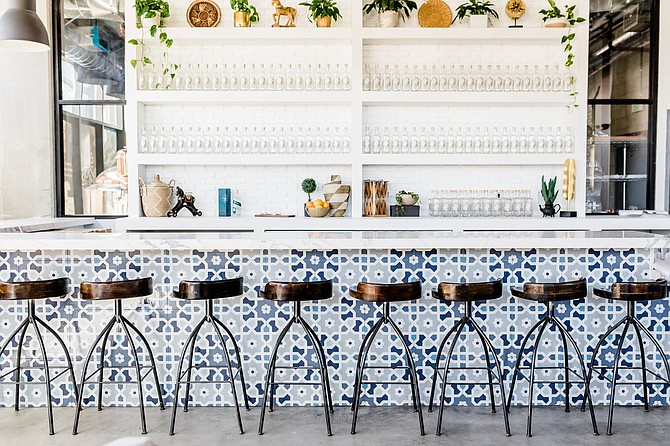 A stylish bar serves cocktails and spirits distilled on site.