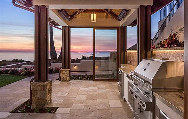 Outdoor kitchen with built-in barbecue and cabana