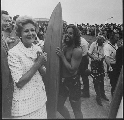 One of the crew trying to avoid contact with Pat Nixon.