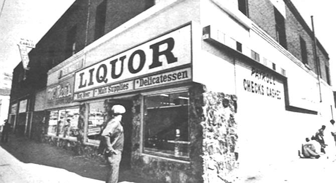 There are only a couple of hippies in front of the Center and a few winos on the side of McKee's liquor store guzzling their Mad Dog and Thunderbird. - Image by Carroll Parrott Blue