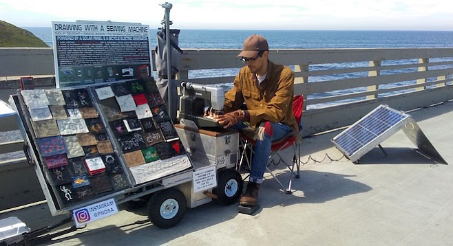 Paul Nosa's sewing trailer is powered by his bicycle's generator and the sun.