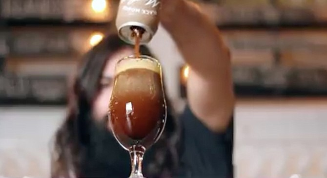 """Screencap from Modern Times' video """"tutorial on how to pour it like a champion"""""""