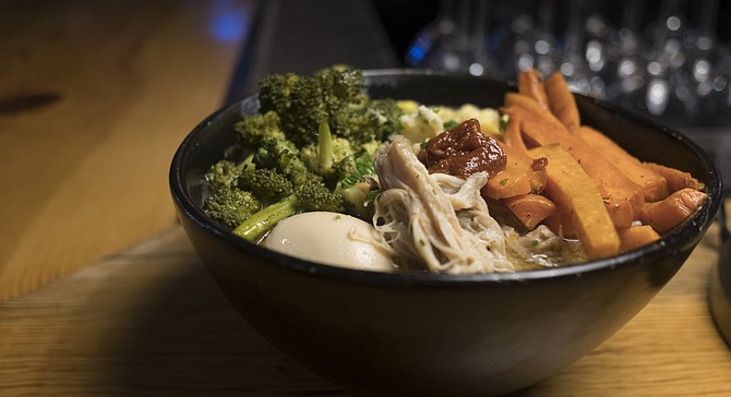 Chicken confit ramen with carrots and broccoli added