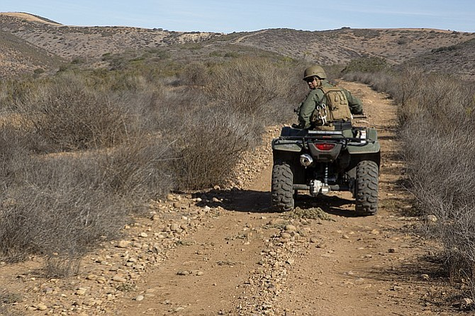 Marine on trail patrol