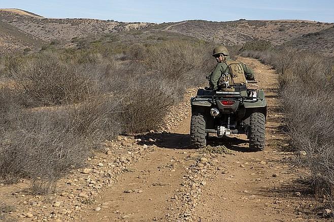 Marine on trail patrol