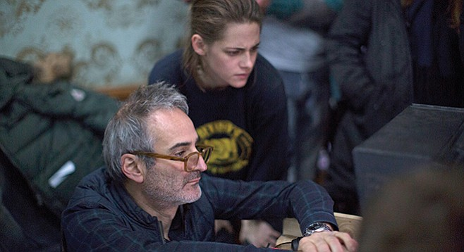 Olivier Assayas and Kristen Stewart consult the video assist during the filming of Personal Shopper.