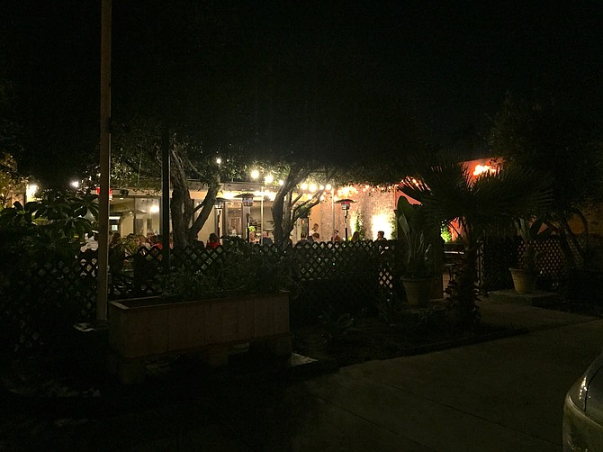 The outside dining area of Donna Jean at night