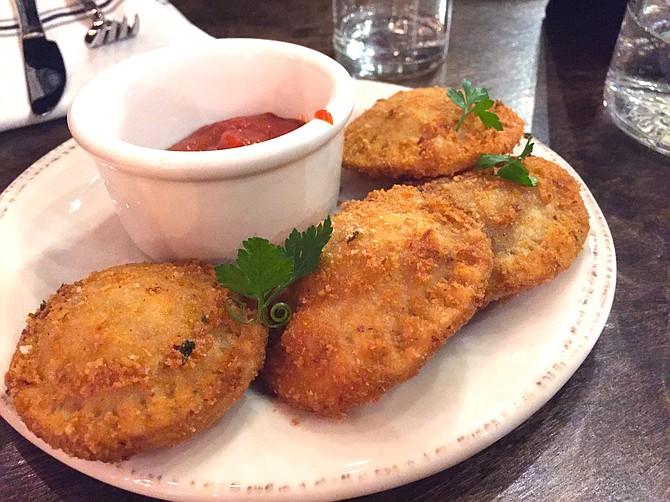 These fried ravioli were served alongside a saffron arrabbiata — great for a group of four