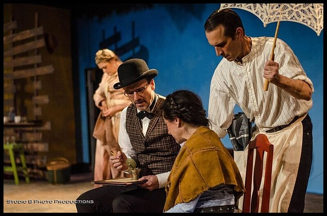 Jacque Wilke, David Raines, Jessica John, and Francis Gercke (with umbrella) search for the elephant in Moxie Theatre's Abundance - Image by Studio B Photo Productions