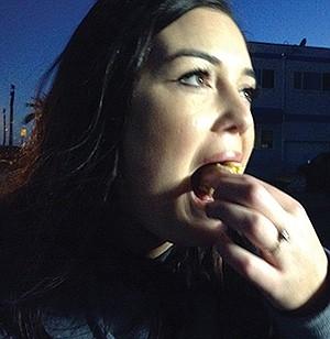Michaela eats her first-ever hot dog