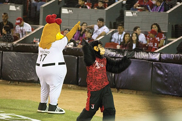 Mascots Pollo Layo (a chicken), Chango 0Te (a monkey) start by throwing bananas into the crowd.
