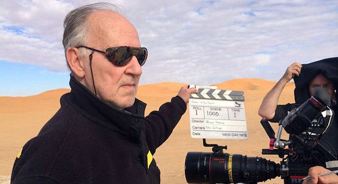Herzog in the desert, directing his Queen.